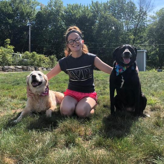 Danielle poses with her dogs.