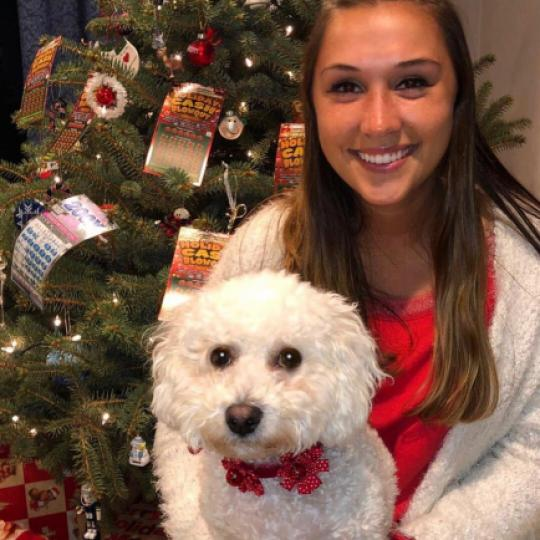 Brooke posing with her dog.