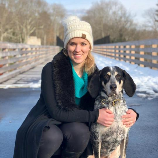 Julie posing with her dog, Ginny.